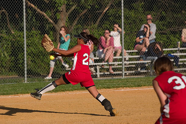 softball pitcher - softball stock photos and pictures