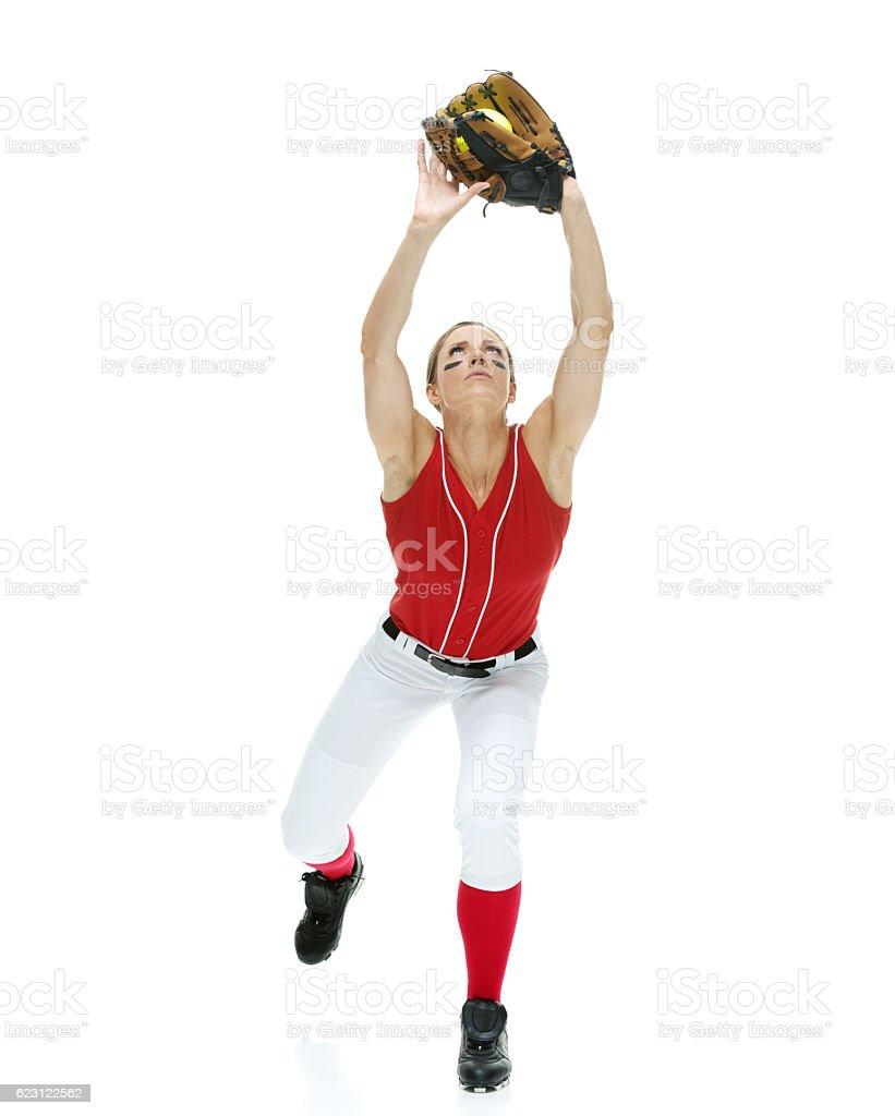 Softball player catching stock photo