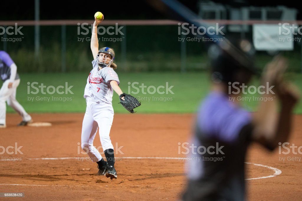 Female Softball Player in Mid Throw