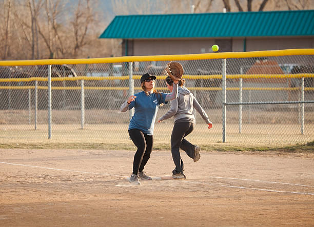 Softball Player tends First Base stock photo