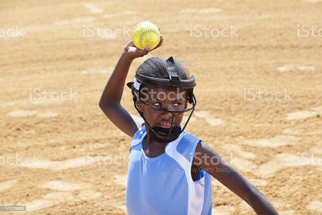 African American girl , infield player, throwing softball. Wearing...