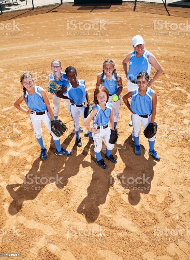 Softball players and coach stock photo