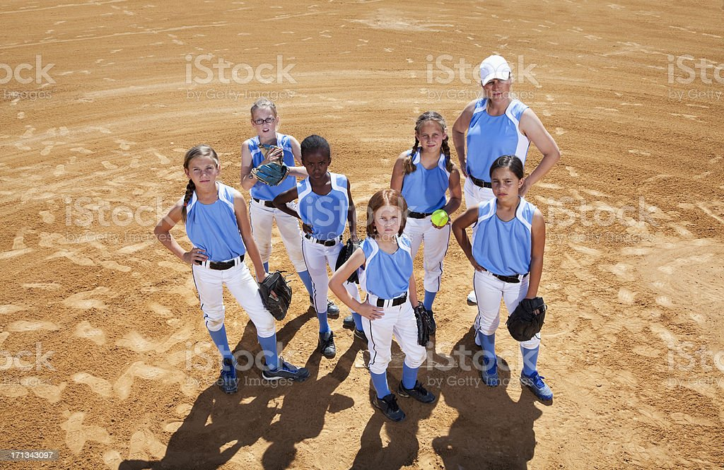 Softball players and coach royalty-free stock photo