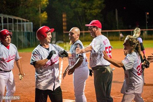 Softball Team Congratulating to a Player.