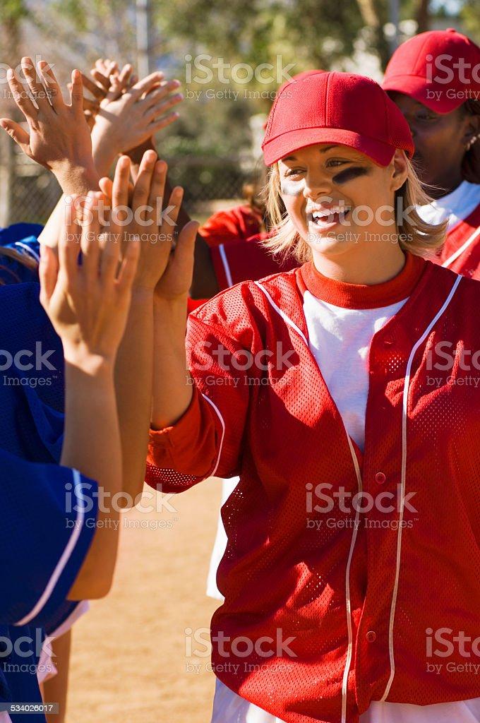 Softball Teams Congratulating Each Other stock photo