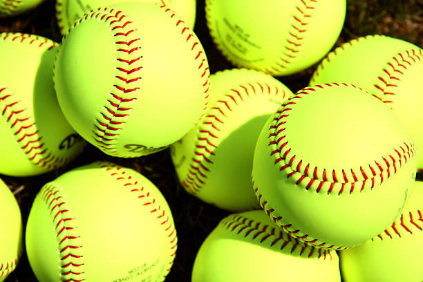 softballs - softball stock photos and pictures