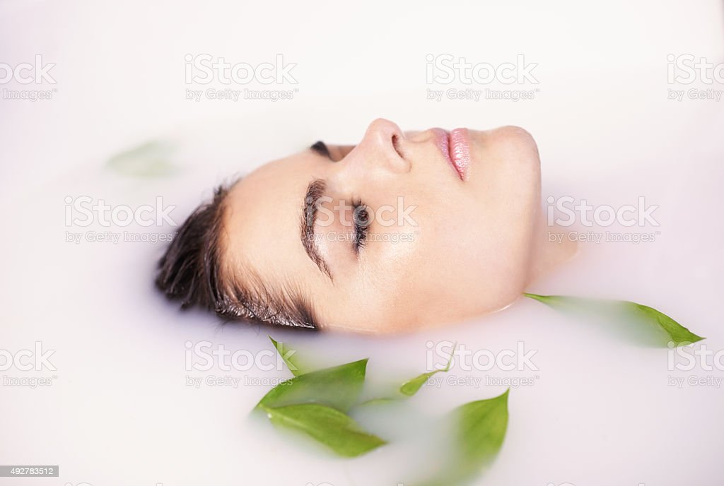 Soften your skin with a milk bath stock photo