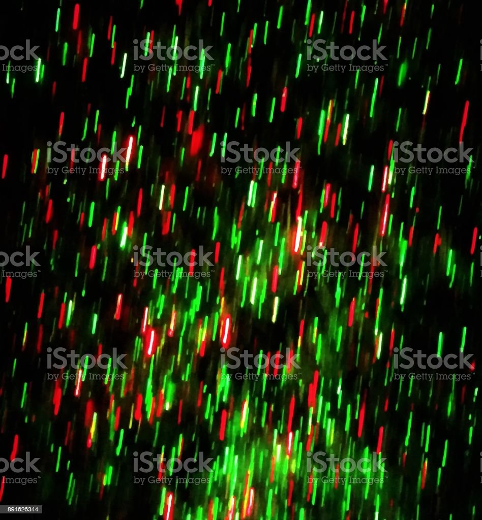 Soft-Focus Projected Green and Red Christmas Lights on a Lawn -- Night stock photo