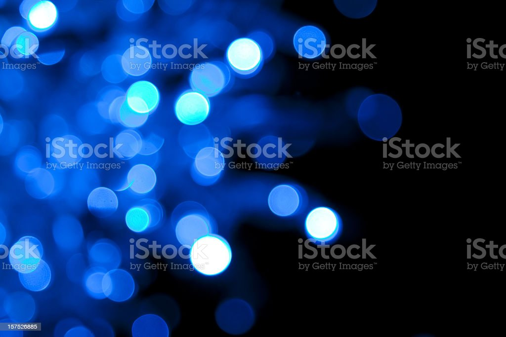 Soft-focus twinkling blue lights on black royalty-free stock photo