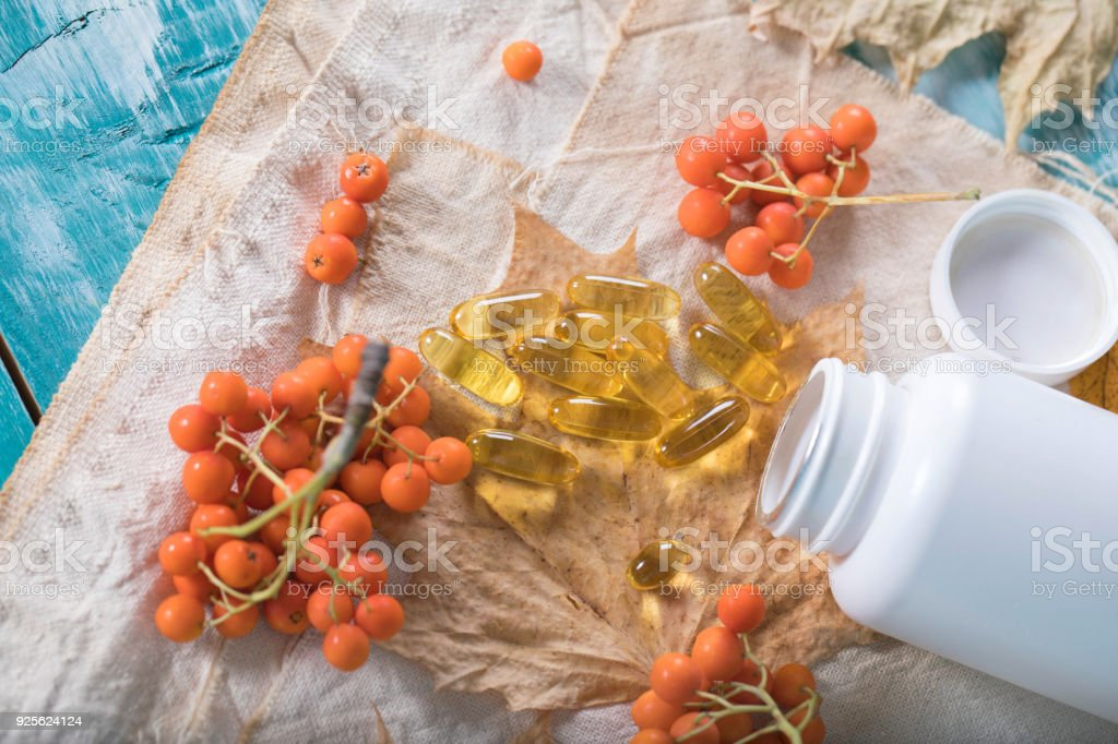 Softgels with rowan berries oil. stock photo