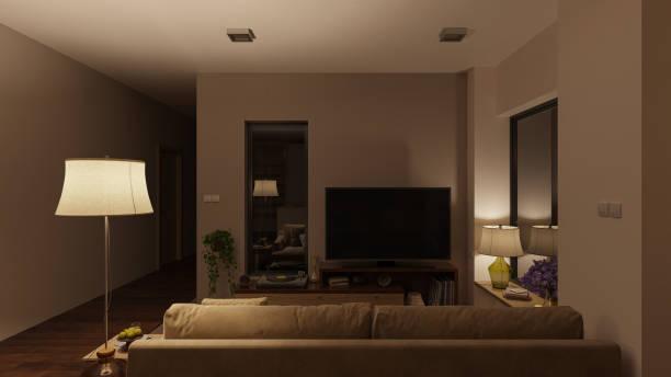 Sanft beleuchtetes Wohnzimmer mit Möbeln bei Nacht – Foto