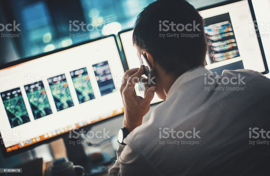 Software developer at work. stock photo