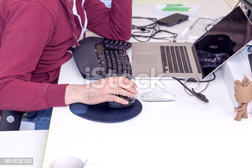 1170085960 istock photo Software developer, coder or programmer working on the computer 954326100