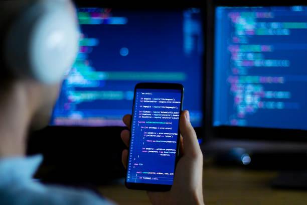 Software developer freelancer working with program code stock photo