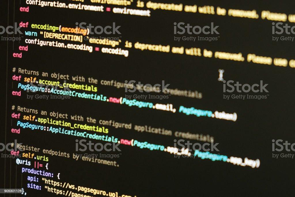Software developer programming code. Abstract computer script stock photo