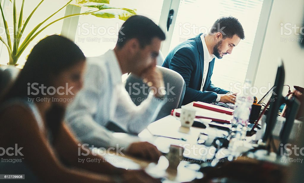 Software developers at work. stock photo