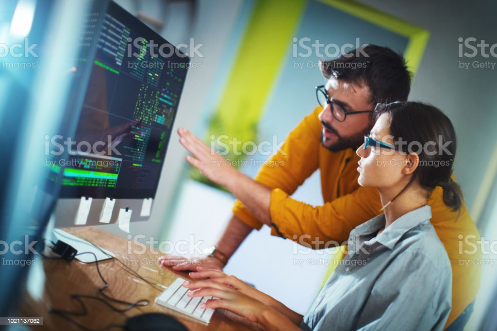 Software developers doing some research. stock photo