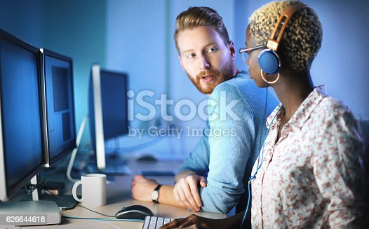 istock Software developers solving a problem. 626644618