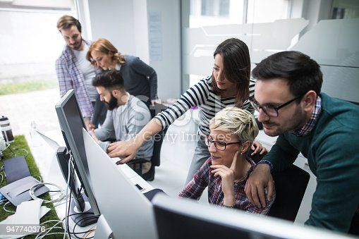 istock Software developers solving a problem 947740376