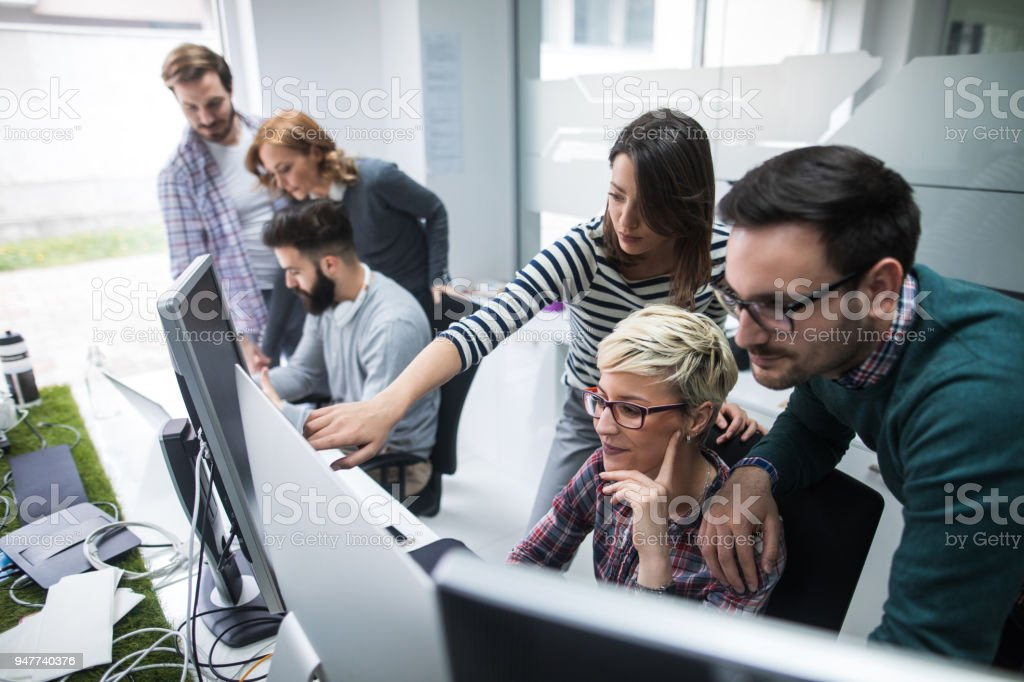 Software developers solving a problem stock photo
