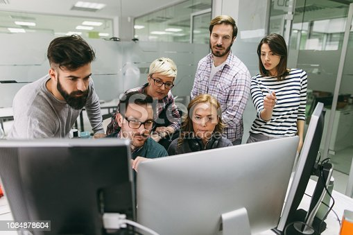 istock Software developers solving a problem together 1084878604