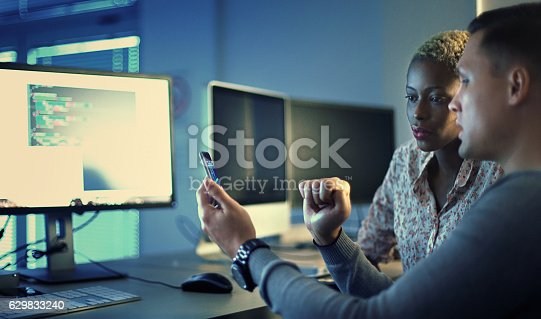 istock Software developers working late. 629833240