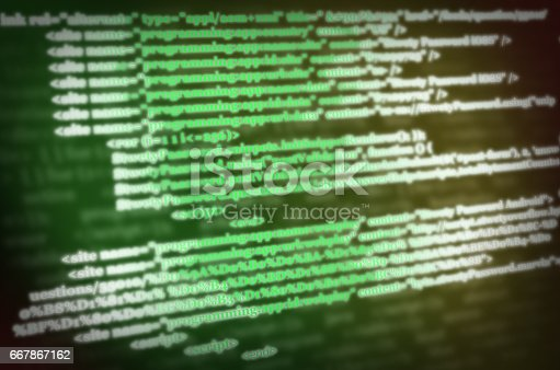 istock Software development. Software source code. Programming code. Writing programming code on laptop. 667867162