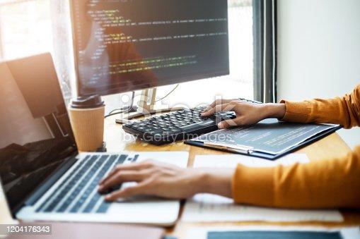 1210151924 istock photo Software engineers programmer development coding a solution data. 1204176343