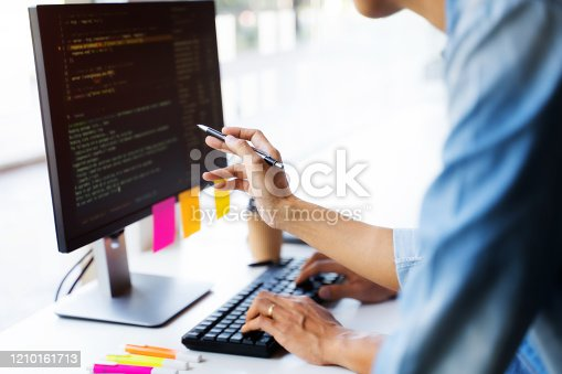 Software engineers programmer development coding a solution data.