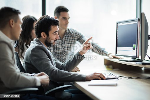 istock Software engineers working in office on project together 638234854