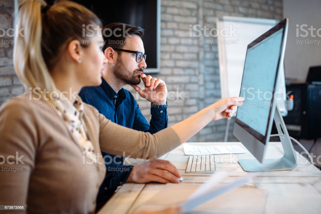 Software engineers working on project and programming in company stock photo