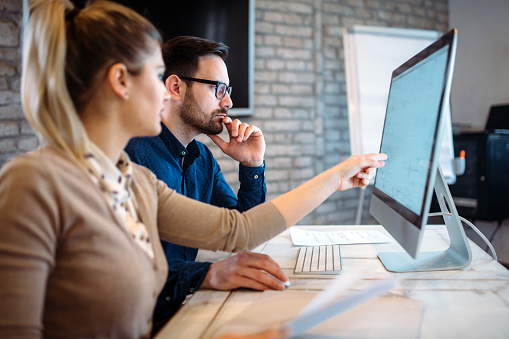 Software Engineers Working On Project And Programming In Company Stock Photo - Download Image Now