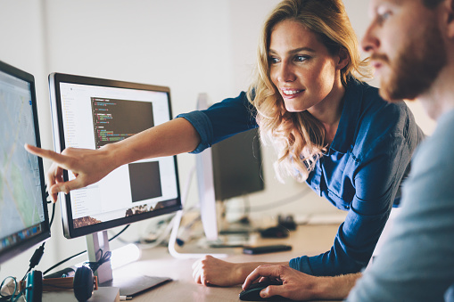 istock Software engineers working on project and programming in company 849858958
