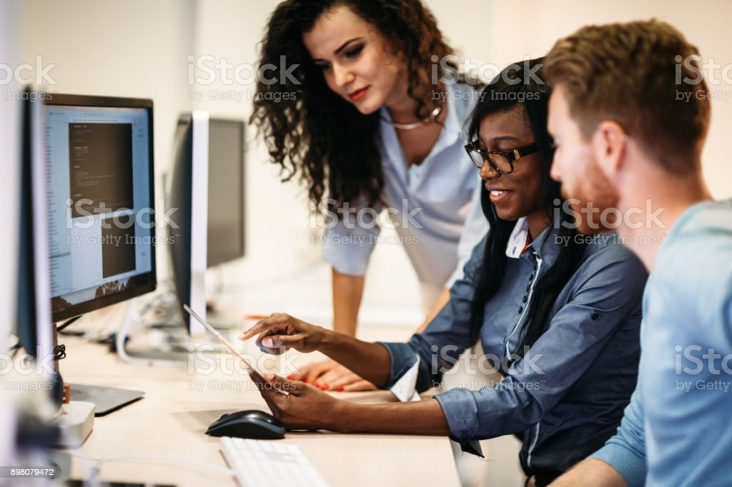 Software engineers working on project and programming in company royalty-free stock photo