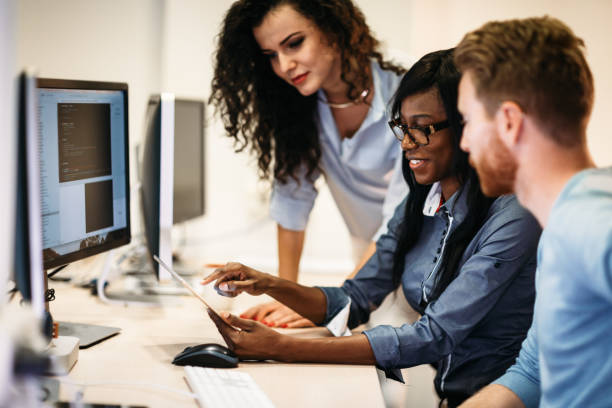 Software engineers working on project and programming in company picture id898079472?b=1&k=6&m=898079472&s=612x612&w=0&h=b6 gcpeo2vxava bzmi0y30lwgnrxtak4zunqytt26c=