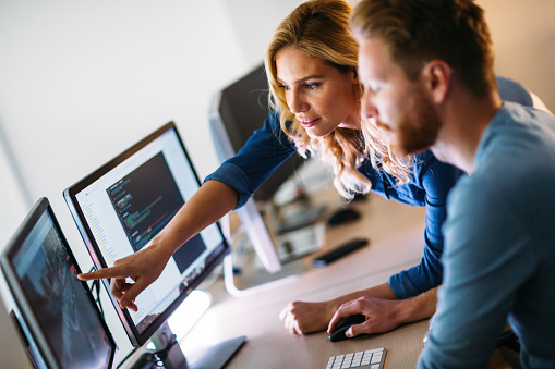 istock Software engineers working on project and programming in company 898079502