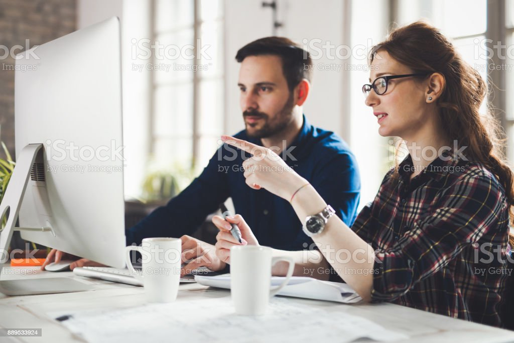 Software engineers working on project stock photo
