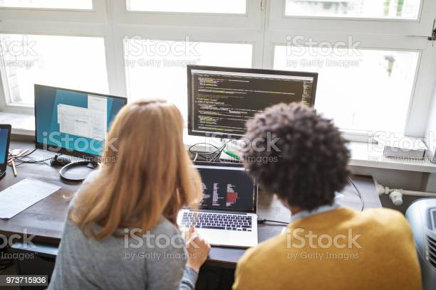 Software Engineers Working Together On New Project Stock Photo - Download Image Now