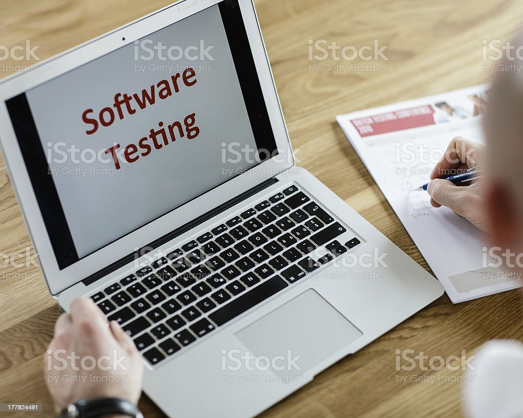 Software Tester at work stock photo