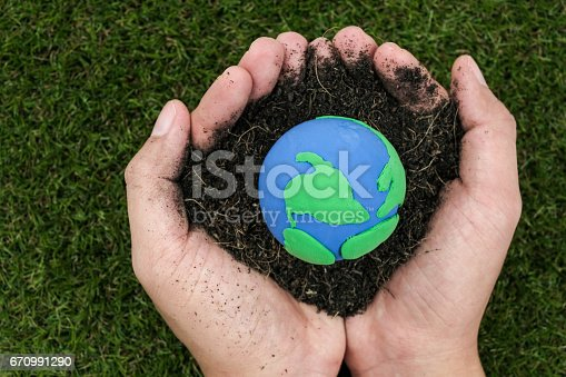 Soil and earth made from clay in hand on white background, earth day concept