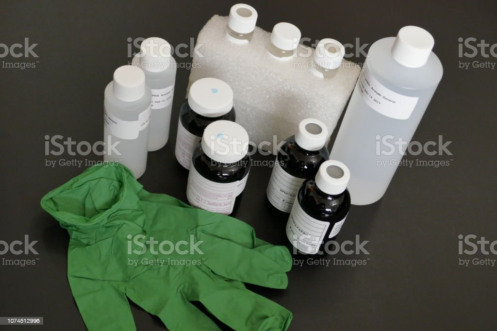 Standard sampling containers and bottles used to collect soil and...