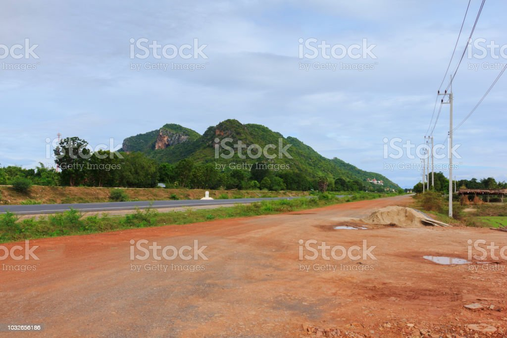 soil road front of mountain view stock photo