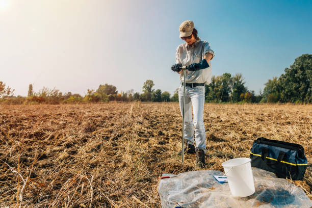 Soil Sampling. Woman Agronomist Taking Sample With Soil Probe Sampler Soil Sampling. Female agronomist taking sample with soil probe sampler. Environmental protection, organic soil certification, research specimen holder stock pictures, royalty-free photos & images