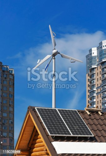 istock Solar and wind energy generators on wooden house. 115028549