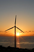 Wind turbine before beautiful sunset by the sea in La Palma, Canary Islands, Spain
