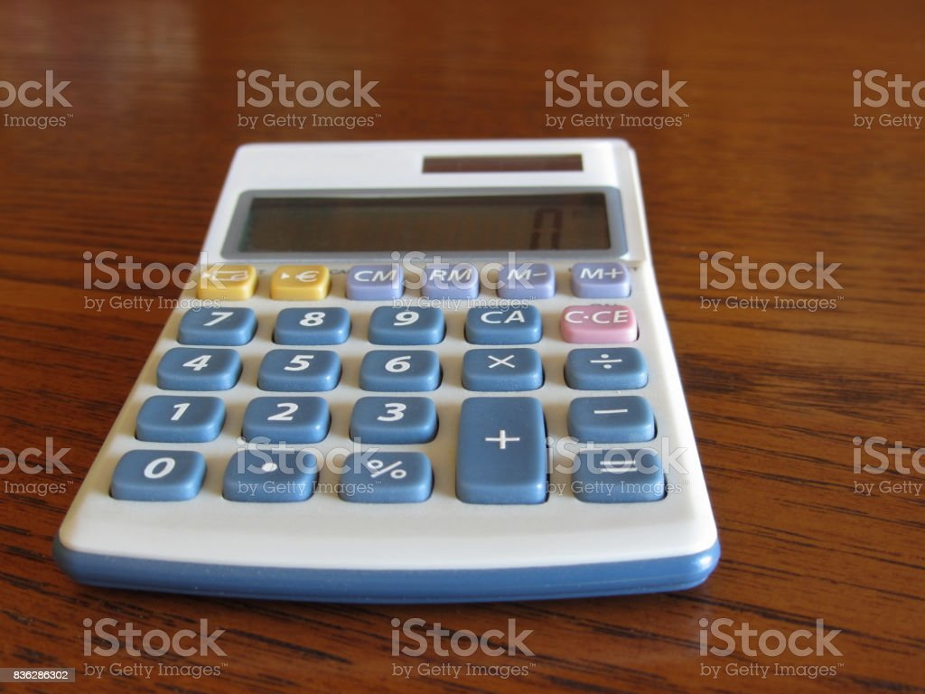 Solar calculator on a wooden table stock photo