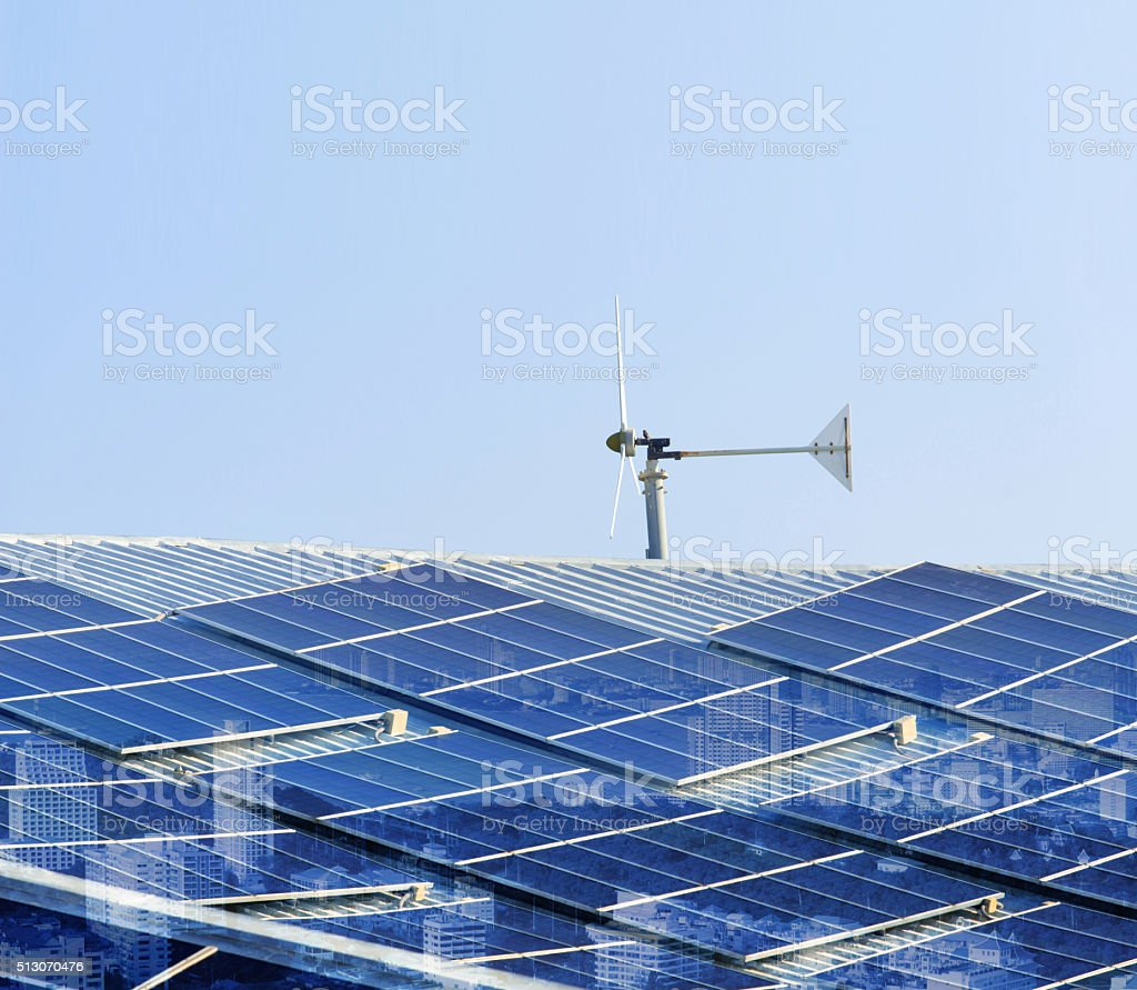 solar cell panel and wind turbines on factory roof stock photo