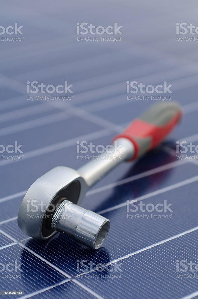 Solar cells and ratchet wrench stock photo