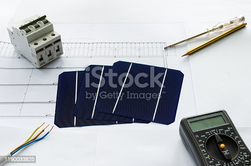 904490858 istock photo Solar cells, fuses, screwdriver, pencil, electrical cable and voltmeter as a concept of planning for photo voltaic project 1190033825