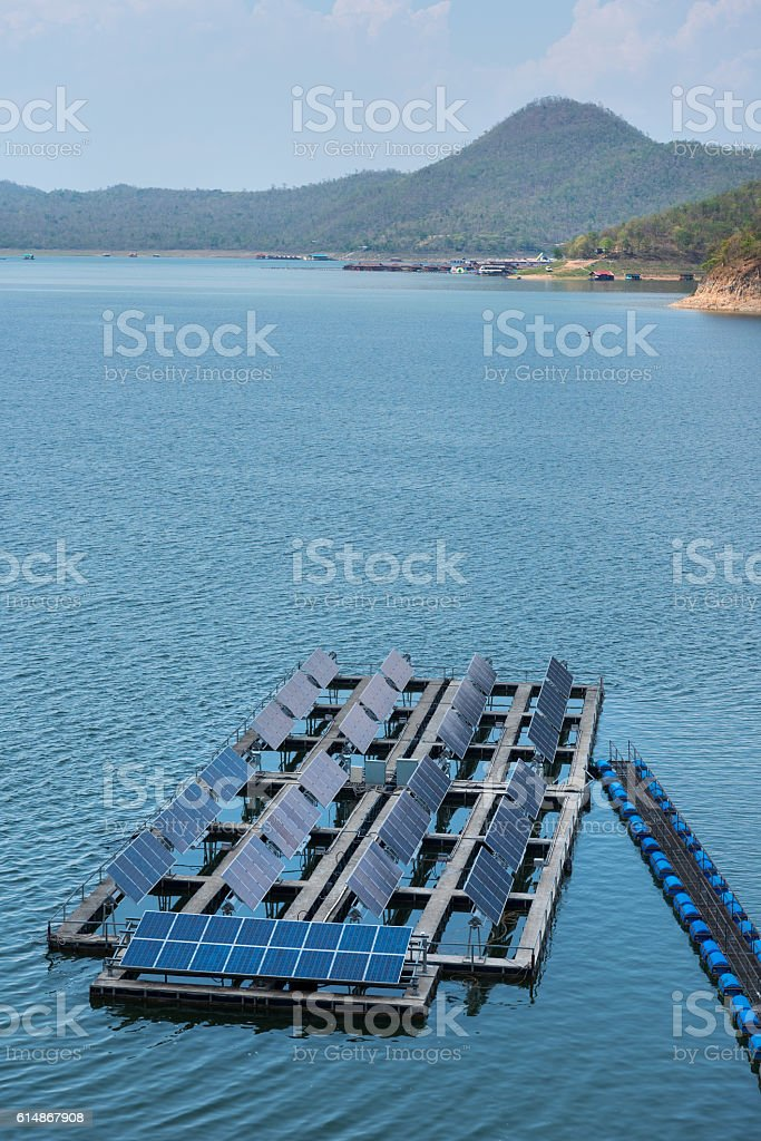 Solar cells on the lake of Srinagarindra Dam stock photo